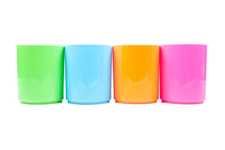 plastic cups colors. Colorful glass arranged in rows. Isolated white background photo