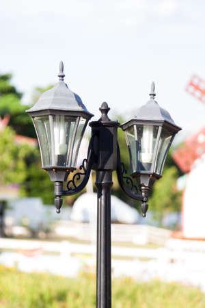 fireproof: Black lamp. The lamp decoration in the garden. A pillar of fire-proof tube two lights. Stock Photo