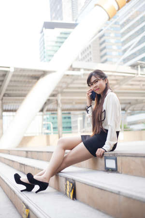 Businesswoman talking phone. Happy while talking on the phone. photo