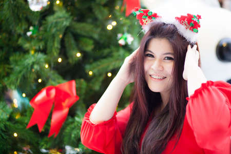 chirstmas: Happy and smile santa woman.relax and smile in christmas day.standing near tree chirstmas and gift.