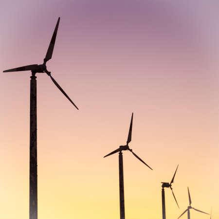 darken: Wind turbines. In the evening, the sun began to darken. Stock Photo