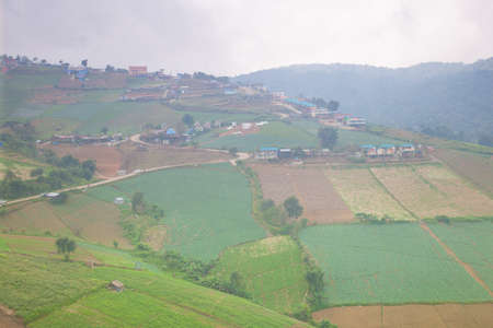 villagers: Agricultural lands in the mountains Villagers cultivated crops on the mountain in general. Stock Photo