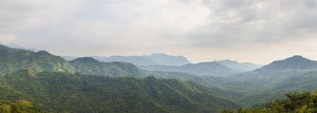 long range: Panorama forest and mountain.Mountains and trees in the wild long range. Stock Photo