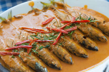 primarily: Fish soup with spicy peppers and spices are composed primarily.