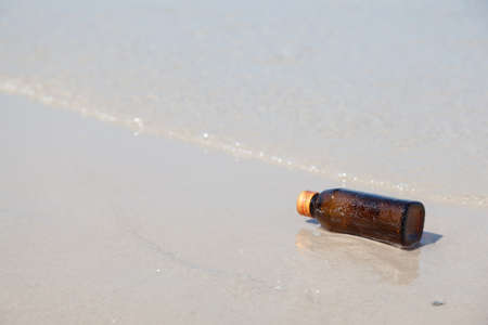 sea pollution: Bottle on a beach. The bottle was left sea. Pollution and environmental problems from waste