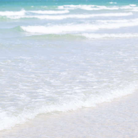 swept: Ocean waves crashing into the beach. Waves from the sea swept shores. Crystal clear water during the daytime.