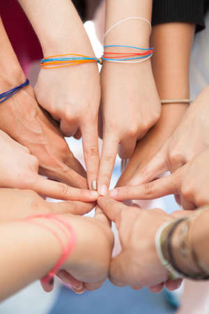 kinship: Hand coordination Used together, the harmonization of teamwork in the workplace. Stock Photo