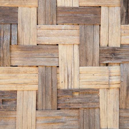polished wood: Background of woven wood Polished wood woven into the background of the wall.