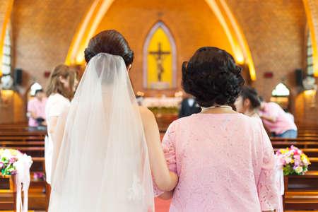 rites: Bride in wedding ceremony Wedding in a church wedding rites of Christianity. Stock Photo