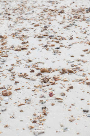small stones: Small stones on the sand. full spread on the beach Stock Photo