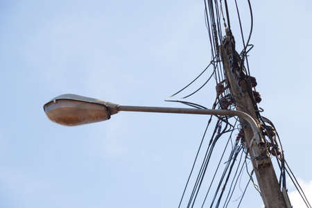 recessed: Recessed lighting and light poles. There are electrical wires and lamps are mounted at the top of the pole.