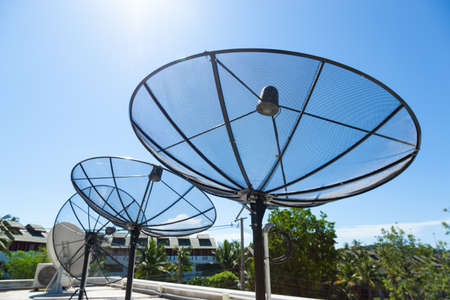 satellite tv: Satellite dishes Mounted on the rooftop of the building. Satellite TV Receiver