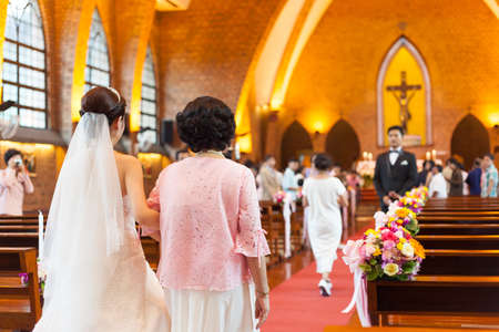 catholic wedding: groom and bride in a wedding ceremony. The ceremony, which was held in the church of Christianity. Editorial