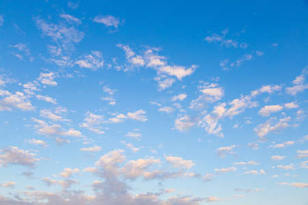 dispersed: Clouds scattered across the sky. The clouds dispersed in a bright clear day. Stock Photo