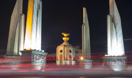 democracy Monument: Democracy Monument in Bangkok city. At night, the lights of cars traveling through. Stock Photo
