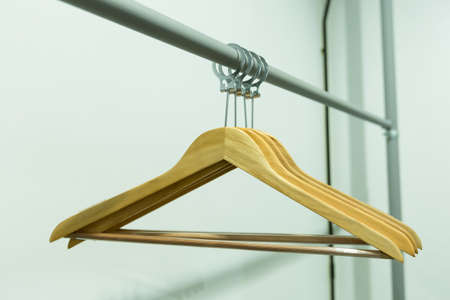coathangers: Coat hanger with a clothes line. Hanger made of wood. Stock Photo