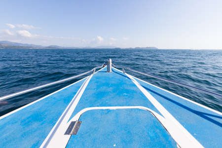 ship bow: front of the boat in the sea. in sea forwart island and port. Stock Photo