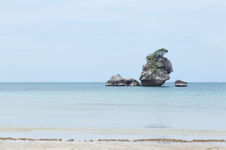 mid morning: Large rocks in the middle of the sea. Stock Photo