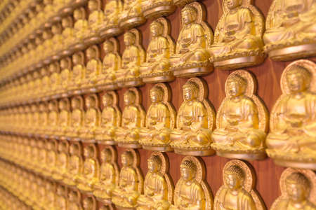 craftmanship: Buddha statue on wall in local temple