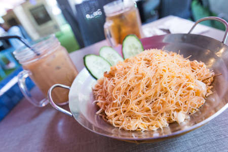 Decorated rice vermicelli fried with milk tea is ready for breakfast and lunch Stock Photo