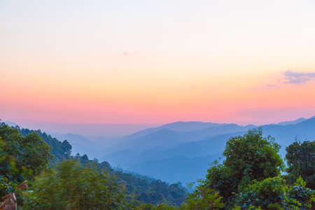 Beautiful morning sunrise in hill with foggy weather Stock Photo