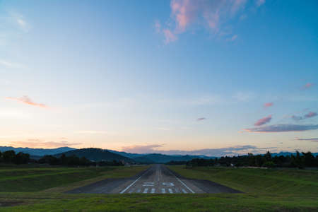 Airport runway sunset. Background mountain and sunset in Thailand.