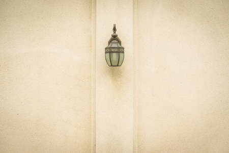 Lamp on brown wall. Classic lamp on home wall. Banco de Imagens