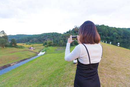 Asian woman  selfie travel in holiday. Background mountain and forest in winter season. Фото со стока