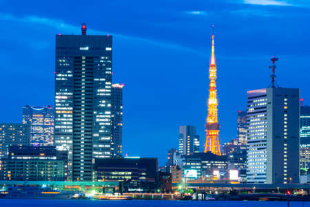 tokyo tower and business building in Tokyo city in night.