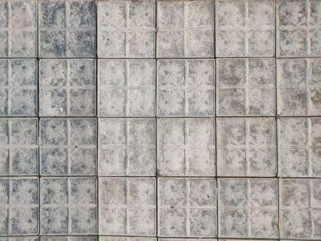 Square pavement textured tiles gray and dark colour stone material 版權商用圖片