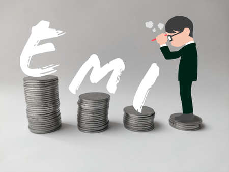 Man standing on stack of coins thinking about EMI