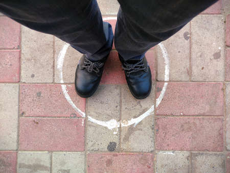 circle on ground for standing in queue , Man feet top view in circle Stock fotó