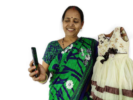 Thanks giving concept by woman thanking for gift or present on smart phone mobile video call to family and friends showing little frock