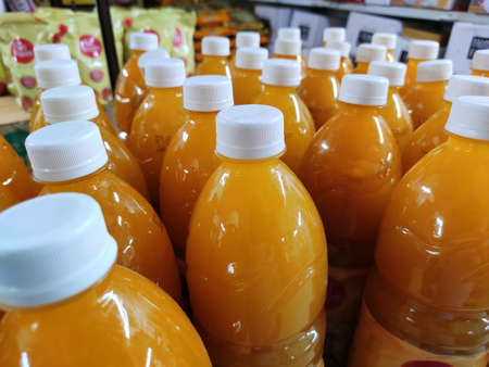 Mango juice packed softdrinks bottle closeup view in market for sale.