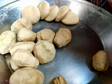 Round dough flour of wheat arranged in plate