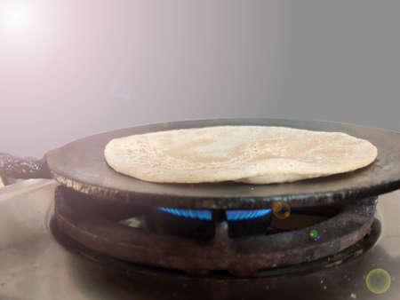 Roti making process , baking on tawa Stock fotó
