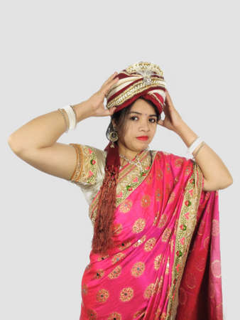 Turban or wreath worn by Indian woman in sari symbolising independent woman concept.