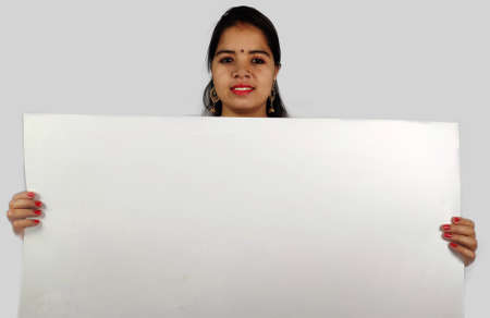 indian woman holding blank white poster Billboard on white background Stock fotó