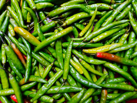 Fresh green chillies spicy pepper background