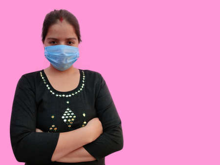 Portrait of young indian woman wearing medical face mask on white background. Protect your health. Coronavirus concept