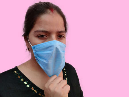 Indian female woman adjusting Face mask , Face closeup portrait view