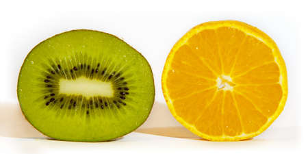 wedge: an orange and kiwi fruit are posing