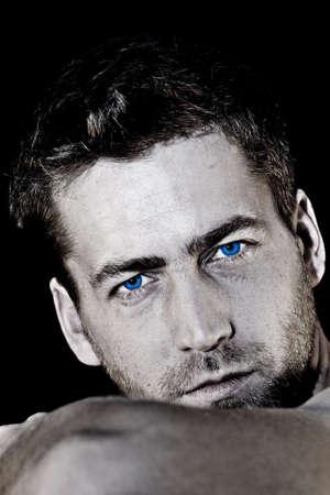 intense: young attractive man closeup portrait of sensual