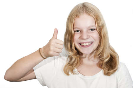 10 years girls: Young blond haired girl gives a OK, good luck sign Stock Photo