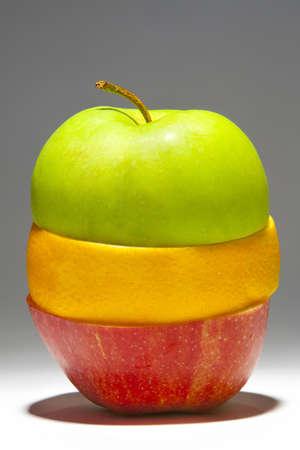stapled: stapled healthy fruits (apple, orange)