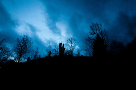 mystic landscape with cloudy sky while the blue hour Stock Photo