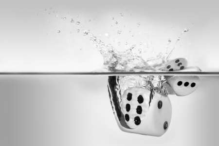 dices: without luck you throw the dice into the water Stock Photo