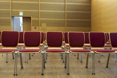 padded: red padded chairs ready for seating in a concert hall
