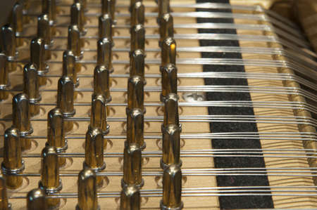 the inside of a grand piano with strings and mechanics Stock Photo