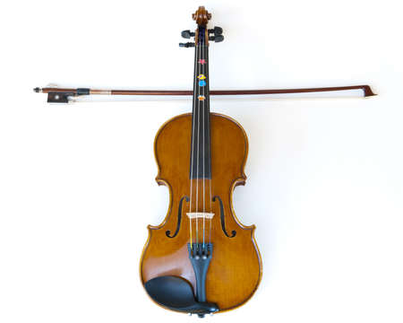 violin making: wooden children violin for learning to play music, fiddle and stick making a cross